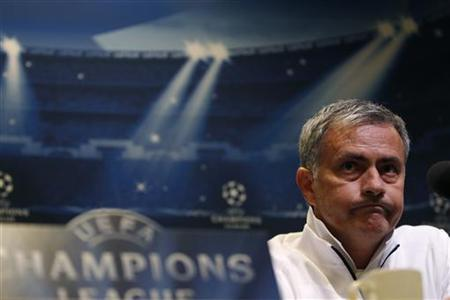 Real Madrid's coach Mourinho addresses a news conference in Dortmund October 23, 2012. REUTERS/Ina Fassbender