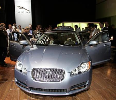People inspect the Jaguar XF vehicle during the Los Angeles Auto Show in Los Angeles, California November 14, 2007. REUTERS/Danny Moloshok