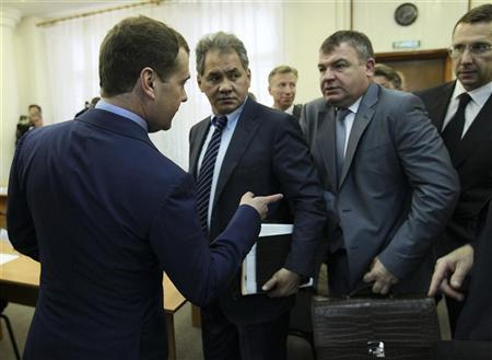 Russia's Prime Minister Dmitry Medvedev (L) talks to then acting Defence Minister Anatoly Serdyukov (2nd R), with Governor of Moscow Region Sergei Shoigu (2nd L) standing nearby, after a meeting on immovable property not used by the Ministry of Defence in Moscow Region, in this file picture taken June 26, 2012. REUTERS/Yekaterina Shtukina/RIA Novosti/Pool