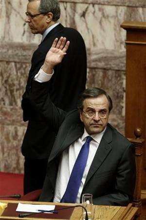 Greece's Prime Minister Antonis Samaras votes during a parliament session in Athens November 8, 2012. Greece's government secured enough votes in parliament on Thursday to pass deeply unpopular austerity measures essential to unlocking further aid from foreign lenders. REUTERS/Yorgos Karahalis (GREECE - Tags: POLITICS BUSINESS)