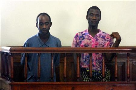 Steven Monjeza (L) and Tiwonge Chimbalanga appear before a magistrate court in Blantyre January 4, 2010. REUTERS/Eldson Chagara