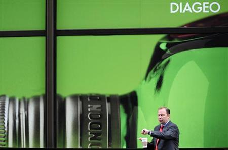A worker walks past the headquarters of Diageo in London, August 27, 2009. REUTERS/Toby Melville
