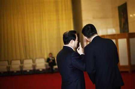 Delegates chat outside of the Guangxi room before a meeting at the Great Hall of the People, the venue of the 18th National Congress of the Communist Party of China in Beijing November 8, 2012. REUTERS/Carlos Barria