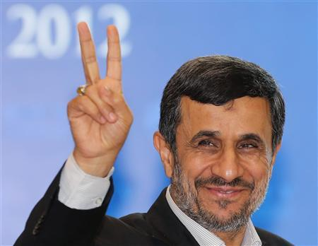 Iranian President Mahmoud Ahmadinejad gives a sign to photographers as he leave the venue after he attended the 5th Bali Democracy Forum in Nusa Dua Bali November 8, 2012. REUTERS/Murdani Usman