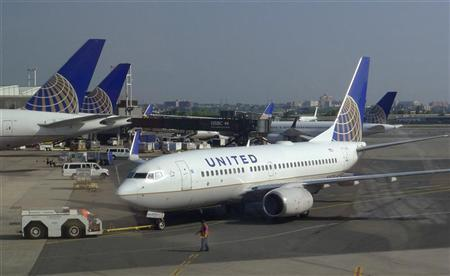 A United Airlines airplane is towed to a gate after arriving at Newark Liberty International Airport in Newark, New Jersey, June 18, 2011. REUTERS/Gary Hershorn
