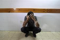A Palestinian mourns the death of Ahmed Abu Dagah, who was killed by gunfire from Israeli forces, at the morgue of a hospital in Khan Younis in the southern Gaza Strip November 8, 2012. REUTERS/Ibraheem Abu Mustafa