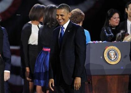 U.S. President Barack Obama smiles while celebrating his re-election during his election night rally in Chicago, Illinois November 7, 2012. REUTERS/Jim Bourg