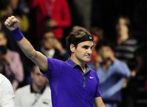 Switzerland's Roger Federer celebrates defeating Spain's David Ferrer in his men's singles tennis match at the World Tour Finals in the O2 Arena in London November 8, 2012. REUTERS/Kieran Doherty