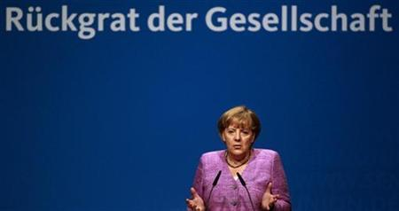 German Chancellor Angela Merkel makes a speech during a senior delegates meeting of the conservative Christian Democratic Union (CDU) in the western city of Recklinghausen, September 3, 2012. REUTERS/Ina Fassbender