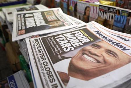 A view shows newspapers with Barack Obama winning the U.S. presidential election on their frontpages, at a news stand in Times Square, New York November 7, 2012. REUTERS/Chip East