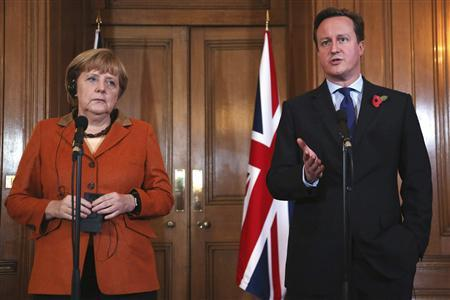 Britain's Prime Minister David Cameron speaks to the media with Germany's Chancellor Angela Merkel (L) at Downing Street in central London November 7, 2012. REUTERS/POOL/Dan Kitwood