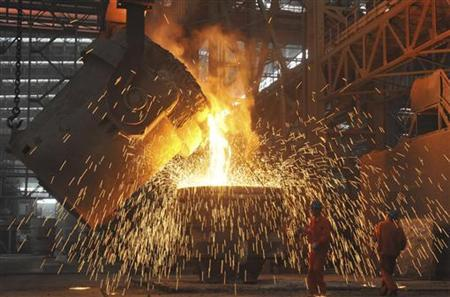 Labourers work at a steel factory in Dalian, Liaoning province July 13, 2012. REUTERS/China Daily