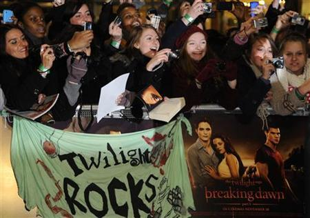Fans react as actors arrive for the British premiere of 'The Twilight Saga: Breaking Dawn' at Westfield in east London November 16, 2011. REUTERS/Toby Melville/Files