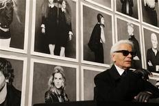 "Chanel's creative director Karl Lagerfeld poses before the opening of his photo exhibition entitled ""Little Black Jacket"" at the Grand Palais in Paris November 8, 2012. REUTERS/Benoit Tessier"