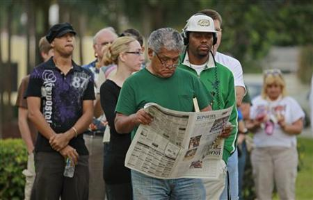 Voters line up to cast ballots in the U.S. Presidential election in Boca Raton, Florida November 6, 2012. REUTERS/Joe Skipper