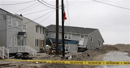 A house was pushed off it's foundation during Hurricane Sandy on Long Beach Island, New Jersey, November 7, 2012 in this handout photo courtesy of the governor's office. Picture taken November 7, 2012. REUTERS/New Jersey Governor's Office/Tim Larsen/Handout