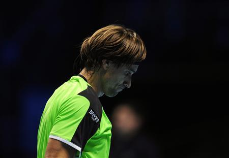 Spain's David Ferrer reacts during his men's singles tennis match against Switzerland's Roger Federer at the World Tour Finals in the O2 Arena in London November 8, 2012. REUTERS/Kieran Doherty