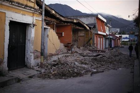 Two men walk past damaged houses after a 7.4-magnitude earthquake struck on Wednesday on the streets of San Marcos, in the San Marcos region, about 250 km (155 miles) south of Guatemala City, November 8, 2012. REUTERS/Jorge Dan Lopez