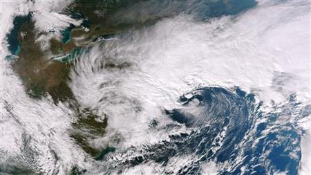 A coastal storm is pictured in the mid-Atlantic off the U.S. Northeast coast in this November 7, 2012 NASA handout satellite image obtained by Reuters November 8. REUTERS/NASA/Handout