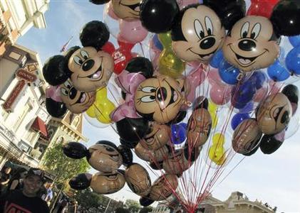 Balloons of Mickey Mouse are carried down main street at Disneyland in Anaheim, California, in this March 11, 2011 file photo. REUTERS/Mike Blake/Files