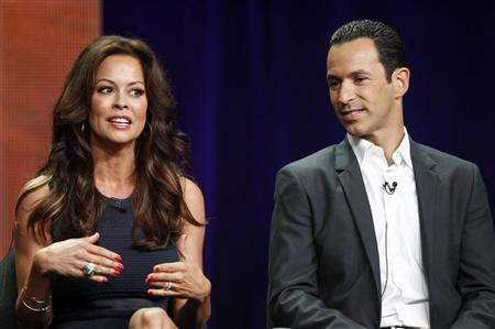 Host Brooke Burke-Charvet, of the upcoming reality series ''Dancing with the Stars: All Stars'' and cast member Helio Castroneves speak during a panel discussion at the Disney-ABC Television Group portion of the Television Critics Association Summer press tour in Beverly Hills, California July 27, 2012. REUTERS/Fred Prouser