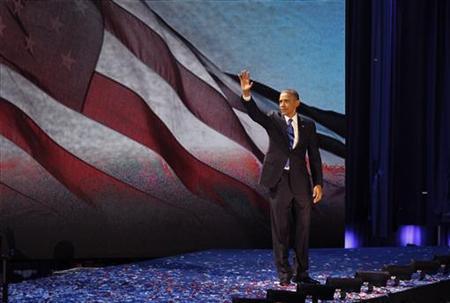 U.S. President Barack Obama celebrates after winning the U.S. presidential election in Chicago, Illinois, November 7, 2012. REUTERS/Jim Bourg