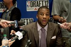 NBA prospect Thomas Robinson speaks during a news conference for prospective NBA draft picks in New York June 27, 2012. REUTERS/Keith Bedford