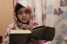 Pakistani schoolgirl Malala Yousufzai reads a book as she recuperates at the The Queen Elizabeth Hospital in Birmingham in this undated handout photograph released on November 8, 2012. REUTERS/Queen Elizabeth Hospital Birmingham/Handout