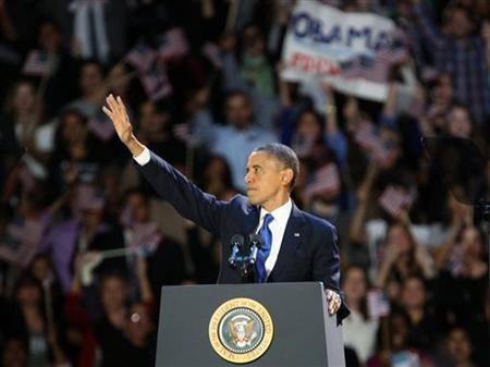 U.S. President Barack Obama acknowledges supporters while at his election night victory rally in Chicago, November 7, 2012. REUTERS/Philip Scott-Andrews