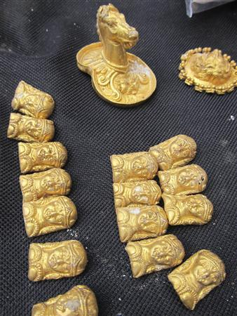 Gold artefacts are seen after they were unearthed from an ancient Thracian tomb near the village of Sveshtari, some 400km (248 miles) north-east of Sofia, November 7, 2012. REUTERS/Emil Iordanov/BGNES