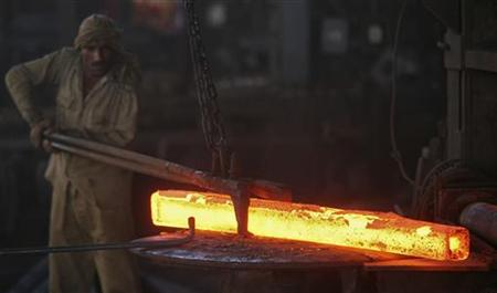 A labourer works inside an iron factory on the outskirts of Jammu October 1, 2012. REUTERS/Mukesh Gupta