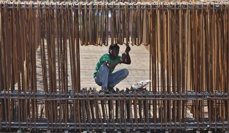 A labourer works at the construction site of a flyover on the outskirts of Ahmedabad September 28, 2012. REUTERS/Amit Dave/Files
