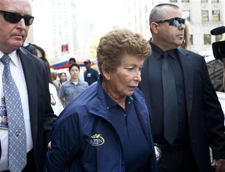 Lois Ann Goodman, 70, is led away from the Manhattan Criminal Court after being extradited to California in the custody of Los Angeles Police Department detectives in New York, August 23, 2012. REUTERS/Andrew Burton