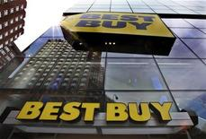 A building is reflected in the glass of a Best Buy store in New York August 21, 2012. REUTERS/Brendan McDermid