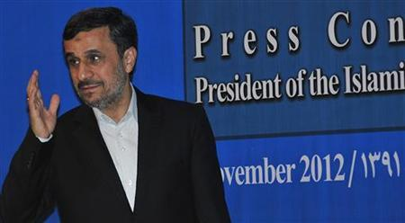 Iran's President Mahmoud Ahmadinejad greets journalists as he arrives for a news conference in Nusa Dua, Bali November 8, 2012. Ahmadinejad is in Bali to attend the 5th Bali Democracy Forum. REUTERS/Stringer (INDONESIA - Tags: POLITICS)