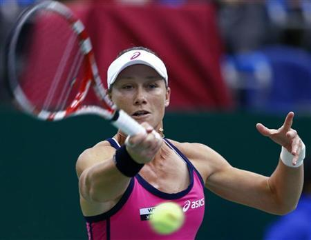 Australia's Samantha Stosur hits a return against Denmark's Caroline Wozniacki during their Kremlin Cup final tennis match in Moscow October 21, 2012. REUTERS/Grigory Dukor