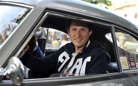 Fiat Chairman John Elkann drives a Fiat 8V at the start of the ''1000 Miglia'' International classic car rally in Brescia in this May 17, 2012 file photo. REUTERS/Paolo Bona/Files