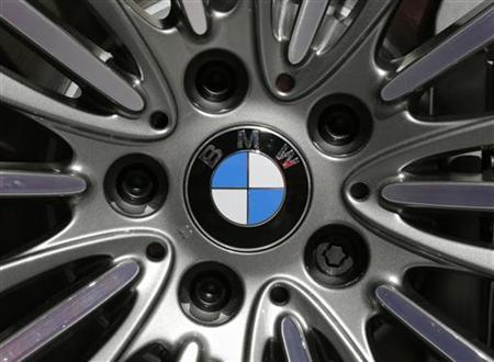 A BMW logo is seen on the rim of a BMW 650i xDrive car on media day at the Paris Mondial de l'Automobile, September 28, 2012. The Paris auto show opens its doors to the public from September 29 to October 14. REUTERS/Christian Hartmann (FRANCE - Tags: TRANSPORT BUSINESS LOGO)