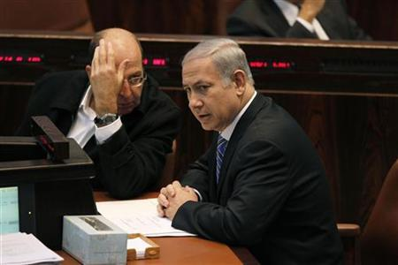 Israel's Prime Minister Benjamin Netanyahu (R) sits next to Vice Prime Minister Moshe Yaalon during a memorial service for the late Israeli Tourism Minister Rehavam Zeevi at the Knesset, the Israeli parliament, in Jerusalem November 2, 2011. REUTERS/Baz Ratner