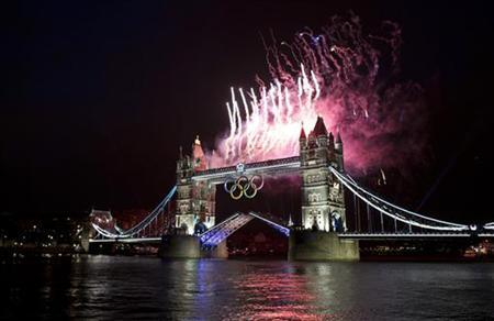 Fireworks explode off the Tower Bridge during the night of the opening ceremony of London 2012 Olympic Games in London July 27, 2012. REUTERS/Mark Blinch/Files