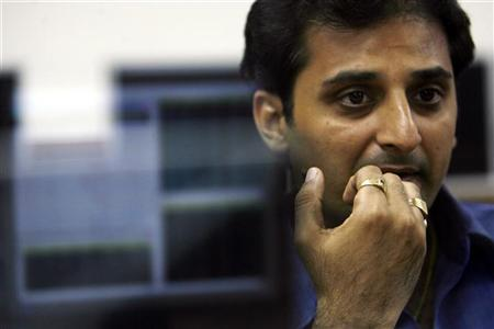 A stockbroker reacts while trading at a stock brokerage firm in Mumbai October 27, 2008. REUTERS/Arko Datta/Files