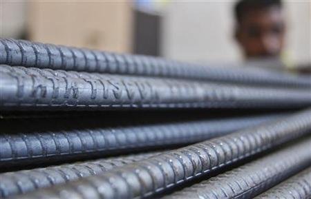 A labourer works at a Tata steel iron godown in Chandigarh November 9, 2012. REUTERS/Ajay Verma