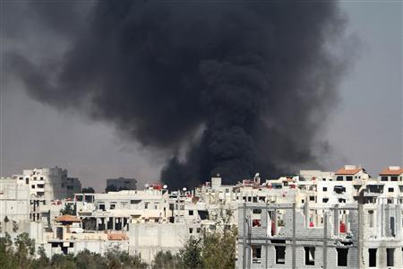 Smoke rises from the eastern Damascus suburbs of Arbeen, after what activists say was an airstrike by a MIG fighter jet, November 8, 2012. Picture taken November 8, 2012. REUTERS/Omar al-khani