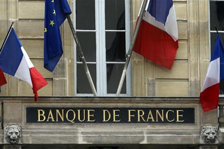 Flags of France and Europe hang on the facade of the Bank of France headquarters in Paris May 9, 2012. REUTERS/Charles Platiau