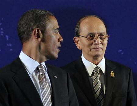 Myanmar's President Thein Sein (R) is pictured alongside U.S. President Barack Obama as they participate in a group photo at the East Asian Summit in Nusa Dua, Bali, November 19, 2011. REUTERS/Jason Reed/Files