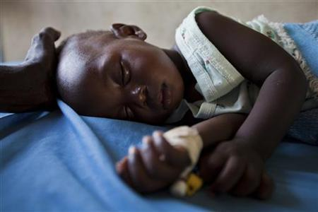 A young girl with malaria rests in the inpatient ward of the Malualkon Primary Health Care Center in Malualkon, in the South Sudanese state of Northern Bahr el Ghazal, June 1, 2012. REUTERS/Adriane Ohanesian