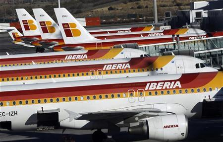 Planes of Spanish airline Iberia are parked on the tarmac during a pilot strike at Madrid's Barajas airport December 18, 2011. REUTERS/Susana Vera