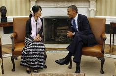 U.S. President Barack Obama speaks with Myanmar opposition leader Aung San Suu Kyi during their meeting in the Oval Office of the White House in Washington September 19, 2012. REUTERS/Kevin Lamarque