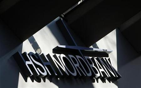 Picture of the HSH Nordbank logo over the entrance to the headquarters of the German bank in Hamburg February 24, 2009. REUTERS/Christian Charisius (GERMANY)