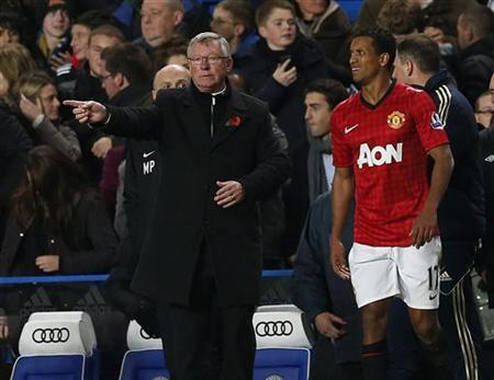 Manchester United's manager Alex Ferguson gestures as Nani looks on during their English League Cup soccer match against Chelsea at Stamford Bridge in London October 31, 2012. REUTERS/Suzanne Plunkett